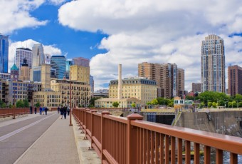the minneapolis skyline as seen from the stone arch bridge, minneapolis, minnesota.